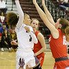 (Brad Davis/The Register-Herald) Woodrow Wilson's Keanti Thompson passes the to the perimeter from underneath the basket as Parkersburg's Maddi Leggett defends Saturday afternoon in Beckley.