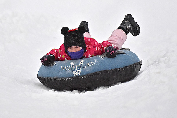 (Brad Davis/The Register-Herald) Nine-year-old North Carolina resident Alyssa Starnes looks ahead as she speeds down the snow tubing track at Winterplace Saturday evening in Ghent. If you were looking forward to playing in some snow, Winterplace was the only place to find it, as a winter storm system moving through the area largely spared us of any real accumulation.