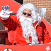 (Brad Davis/The Register-Herald) Santa waves to the crowd during the Beckley Christmas Parade Saturday morning.