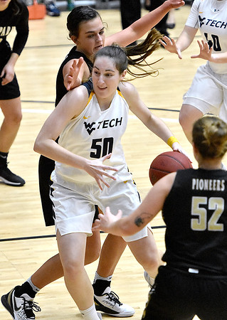 (Brad Davis/The Register-Herald) WVU Tech's Laura Requena works her way into the paint as Point Park's Carly Lutz, left, and Taylor Rinn (#52) defend Saturday afternoon at the Beckley-Raleigh County Convention Center.