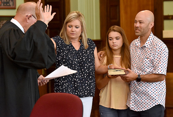 (Brad Davis/The Register-Herald) Lori Tabit is sworn in as Fayetteville Councilperson during the town's Swearing In Ceremony Friday evening inside the Fayette County Courthouse.