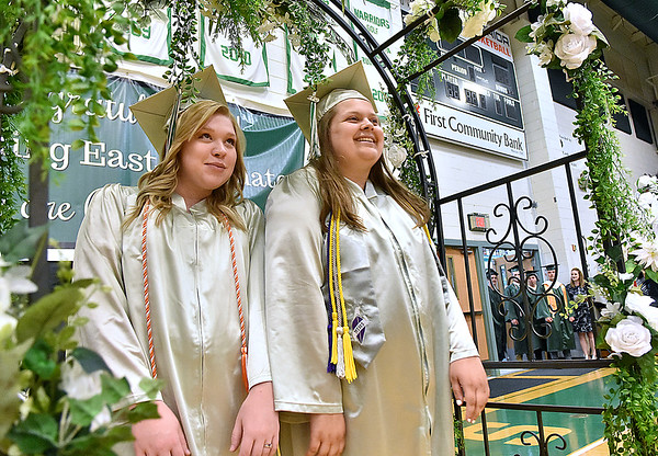(Brad Davis/The Register-Herald) Graduating Wyoming East seniors enter the gym as the school's 2019 Commencement Ceremony gets underway Friday night in New Richmond.