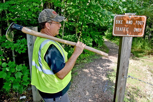 (Brad Davis/The Register-Herald) Gary Morefield, recently appointed as the City of Beckley's Trails Specialist, sets out to inspect and work on the trails around the YMCA Paul Cline Memorial Sports Complex Wednesday afternoon.