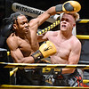 """(Brad Davis/The Register-Herald) Bluefield's Jaquan Ebron, left, and Huntington's Seth """"Rowdy"""" Finnegan slug it out in a light heavyweight matchup during the Original Toughman Contest Friday night at the Beckley-Raleigh County Convention Center. Ebron would win the fight."""