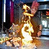 (Brad Davis/The Register-Herald) Kimono Kin hibachi chef Wahyu Burhani works his magic as he prepares food for observing customers Sunday afternoon. Kimono is open today during Labor Day.