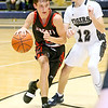 (Brad Davis/The Register-Herald) Liberty's Braden Howell starts a drive from the perimeter as Shady Spring's Todd Duncan defends Wednesday night in Shady Spring.