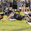 (Brad Davis/The Register-Herald) Wyoming East's Caleb Bower dives across the goal line to score the game's opening touchdown out of the reach of Westside defender Hunter Lester Friday night in New Richmond.