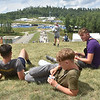(Brad Davis/The Register-Herald) British scouts Elliot Robinson-Randell, middle, Oliver Malkin, right, and Blue Singleton, left, relax on a hill overlooking a basecamp during the last day of World Scout Jamboree activities Thursday afternoon at the Summit Bechtel Reserve.