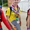 (Brad Davis/The Register-Herald) A passing scout with American flags in her hair notices the camera during the last day of World Scout Jamboree activities Thursday afternoon at the Summit Bechtel Reserve.