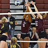 (Brad Davis/The Register-Herald) George Washington's Nyla Birch (#5) and Katherine Triplett block a spike attempt from Greenbrier East's Haley McClure during the Class AAA Region 3 championship tournament Saturday evening in Beckley.