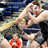 (Brad Davis/The Register-Herald) Shady Spring's Kolby Ellis takes on Liberty's Devin Vance in a 220-pound weight class matchup during the Appalachian Fasteners Invitiational Saturday afternoon in Shady Spring. Shady's Ellis won the match.