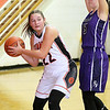 (Brad Davis/The Register-Herald) Summers County's Maggie Stover looks for an open teammate along the baseline as River View's Kristen Calhoun defends Saturday night in Hinton.