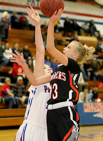 (Brad Davis/The Register-Herald) Summers County's Sullivan Pivont drives to the basket as Midland Trail's Meghan Gill defends Wednesday night in Hico.