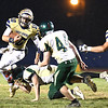 Drew Clark, of Shady Spring, left, breaks away for some extra yards against Braxton Co. at Shady Spring High School.<br /> (Rick Barbero/The Register-Herald)