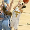 (Brad Davis/The Register-Herald) Greenbrier East's Amya Damon puts up a floating shot in the paint as Spring Valley's Skylar Webb defends during Big Atlantic Classic action Wednesday night at the Beckley-Raleigh County Convention Center.