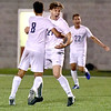 (Brad Davis/The Register-Herald) WVU Tech's Fletcher Caponecchia is hugged by teammate Sergio Sanchez (#8) after scoring a goal during the Golden Bears' win over University of Maine at Fort Kent Wednesday night at the YMCA Paul Cline Memorial Soccer Complex.