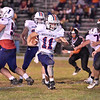 (Brad Davis/The Register-Herald) Independence ball carrier Phillip Spurlock gets through the Summers County defense en route to a long touchdown run Friday night in Hinton.