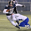 (Brad Davis/The Register-Herald) Nicholas County ball carrier Jeffrey Girod rumbles through a tackle attempt from Princeton defender Carter Meachum at the goal line to score a first half touchdown Friday night in Summersville.