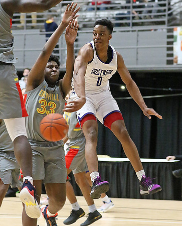 (Brad Davis/The Register-Herald) Crestwood Prep's Jahcobi Neath kicks the ball to an open teammate in the paint at the end of a drive as Oak Hill Academy's B.J. Mack defends during Big Atlantic Classic action Wednesday night at the Beckley-Raleigh County Convention Center.