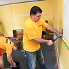 Barry Wiley, WVU Tech student, right and other volunteers cleaning and prepping WV HIVE's new expansion site at Beckley Presbyterian Church on South Kanawha Street in Beckley Tuesday morning. Students volunteered hundreds of hours at multiple service sites on Tuesday, Volunteers served at nearly 20 sites over the course of five hours. Other notable projects; cleaning buses and assisting on ride-alongs with the Raleigh County Community Action Association, New River Transit Authority; and trail cleanup at Little Beaver State Park. <br /> (Rick Barbero/The Register-Herald)