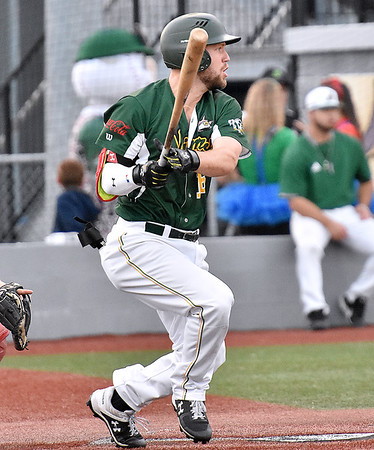 (Brad Davis/The Register-Herald) Miners batter Caleb Walls singles off Danville relief pitcher Tanner Green to drive in teammate Kyle Schaefer and advance Chaz Bertolani to 2nd during the Miners' three-run 4th inning Friday night at Linda K. Epling Stadium.
