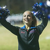 A Midland Trail cheerleader working the pom poms after her team scored a touchdown. Chad Foreman for the Register-Herald.