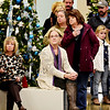 People look on during the 11th annual United Way of Southern West Virginia's Wonderland of Trees Auction at the J.W. And Hazel Ruby West Virginia Welcome Center in Mt. Hope on Friday. (Chris Jackson/The Register-Herald)