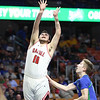 Oak Hill's Dante Billeter (10) puts a jumper up during their West Virginia State Championship Class AA Quarter Finals game against Robert C. Byrd in Charleston on Thursday. (Chris Jackson/The Register-Herald)