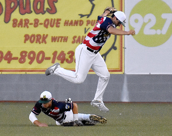 (Brad Davis/The Register-Herald) Miners centerfielder Matt Rubayo leaps to avoid a collision with rightfielder James Jones after catching a fly ball from Lafayette's Max Montgomery Saturday night at Linda K. Epling Stadium.