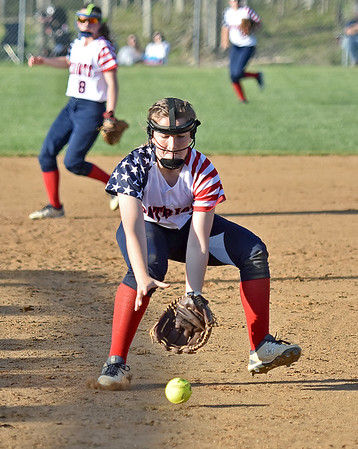 (Brad Davis/The Register-Herald) Independence 3rd baseman Caroline Parrish rushes in to field a Herbert Hoover bunt Wednesday evening in Coal City.