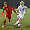 (Brad Davis/The Register-Herald) WVU Tech's Michael Barton moves the ball as he's pursued by Rio Grande's Ewan McLauchlan Thursday night at the YMCA Paul Cline Memorial Soccer Complex.