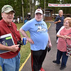 (Brad Davis/The Register-Herald) Maryland residents Arnie Lilly, left, son Edward Lilly, middle, and wife Shirley Lilly notice the camera as they mingle with Lilly's from all over during the 90th annual Lilly Family Reunion Saturday afternoon in Flat Top.