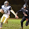 (Brad Davis/The Register-Herald) Shady Spring quarterback Drew Clark gets away from Liberty pass rusher Andrew Ellis as he's flushed from the pocket Friday night in Glen Daniel.