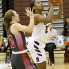 (Brad Davis/The Register-Herald) Woodrow Wilson's Victoria Staunton drives and scores as Cabell Midland's Emilie Charles defends Friday night in Beckley.