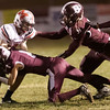 Ryan Wolfe (8) and Jackson Oxley (51) stop a Cabell Midland ball carrier. Chad Foreman for the Register-Herald.