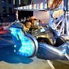 (Brad Davis/The Register-Herald) Kids ride the rides inside the carnival area Saturday night.