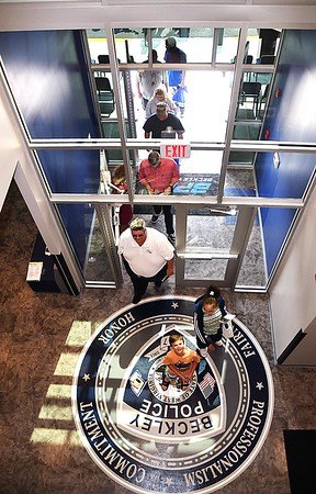 People entering the Beckley Police Department on 501 Neville Street after the ribbon ribbon cutting dedication ceremony for a tour of the new building.<br /> (Rick Barbero/The Register-Herald)