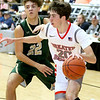 (Brad Davis/The Register-Herald) Greater Beckley Christian's Thad Jordan drives around Notre Dame's Dre'Mir Hausvater along the baseline Saturday night at the Little General Battle for the Armory.