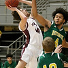 (Brad Davis/The Register-Herald) Woodrow Wilson's Danny Bickey drives and scores as Huntington's Tajhan Blackwell defends Wednesday night at the Beckley-Raleigh County Convention Center.