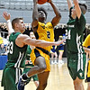 (Brad Davis/The Register-Herald) WVU Tech's Darrin Martin drives and scores as Point Park's Garret McHenry, left, and Kameron Shockley defend Saturday afternoon at the Beckley-Raleigh County Convention Center.