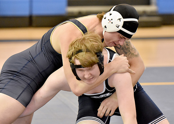 (Brad Davis/The Register-Herald) Shady Spring's Dylan McCall, top, takes on Man's Jason Ritts in a 195-pound weight class matchup during the Appalachian Fasteners Invitiational Saturday afternoon in Shady Spring. Man's Ritts won the match.