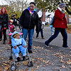 (Brad Davis/The Register-Herald) A young passenger has fallen asleep despite the ghoulish chaos going on all around during trick or treating along Orchard Avenue Saturday.