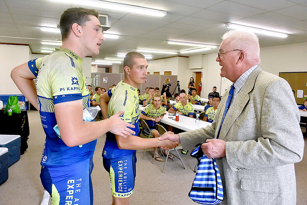 (Brad Davis/The Register-Herald) Colorado cyclists and Phi Kappa Phi fraternity members Tyler Kelley (Denver), left, and Jason Heister (Colorado Springs), middle, shake hands with Beckley mayor Rob Rappold after arriving at the Mountain State Centers for Independent Living from Charleston along with 21 other riders participating in the Journey of Hope TransAmerica cross-country bicycle trek Friday afternoon. Roughly 70 cyclitsts broken into three groups, or routes, are biking across the country from Seattle, Washington to Washington D.C. to raise funds and awareness for people with disabilities. After a brief greeting Mayor Rappold gave each rider a commemorative city coin and an official proclamation was read.