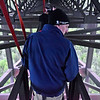 (Brad Davis/The Register-Herald) Buchannon resident Clint Manns looks down towards the New River from the catwalk as he and others participate in an Easter morning sunrise Bridge Walk.