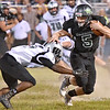 (Brad Davis/The Register-Herald) Wyoming East's Chase York carries the ball as Westside's Isaac Mosley tries to make a tackle Friday night in New Richmond.