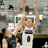 (Brad Davis/The Register-Herald) Shady Spring's Tommy Williams shoots as Wyoming East's Chase York defends on Big Atlantic Classic Championship Saturday at the Beckley-Raleigh County Convention Center.