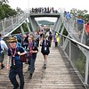 Scouts crossing over the Consul Energy Bridge during the World Scout Jamboree at the Summit Bechtel Reserve in Glen Jean.
