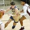 (Brad Davis/The Register-Herald) Shady Spring's Greyson Shephard drives along the baseline as Woodrow Wilson's Bryant Jones defends Saturday night at the Little General Battle for the Armory.