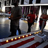 (Brad Davis/The Register-Herald) Attendees walk two by two in honor of the World Trade Center's twin towers holding electric candles during the vigil portion of the 13th annual 9/11 Memorial Service at the Lewis Christian Community Center Wednesday night in Oak Hill.