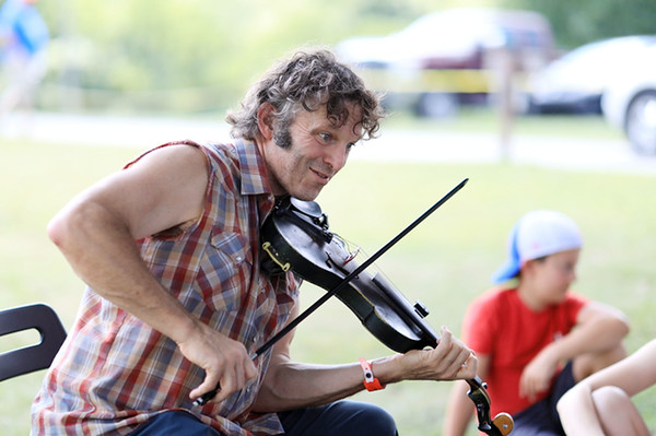 John Magee, from Magee, Miss., plays his fiddle during the Appalachian String Band Music Festival in Clifftop on Thursday. Magee said he has been coming to the annual event for 15 years. (Chris Jackson/The Register-Herald)